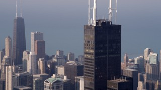 AX0001_113 - 5K stock footage aerial video fly by the Willis Tower Skydeck on a hazy day, Downtown Chicago, Illinois