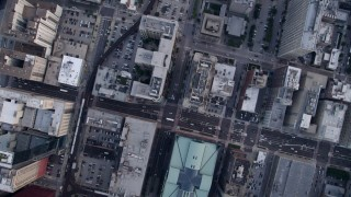 AX0001_142 - 5K stock footage aerial video of a bird's eye view of Harold Washington Library Center and S State Street, Downtown Chicago, Illinois