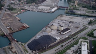 AX0001_163 - 5K stock footage aerial video tilting up the Calumet River, revealing industrial buildings and bridges, East Side Chicago, Illinois