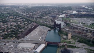 AX0001_164 - 5K stock footage aerial video following Calumet River toward the High Bridge and Chicago Skyway, on a hazy day, Illinois