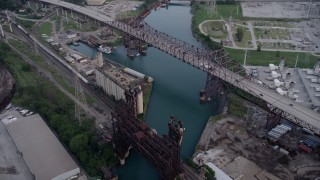 AX0001_165 - 5K stock footage aerial video approach grain elevator between High Bridge and Chicago Skyway spanning Calumet River, East Side Chicago, Illinois