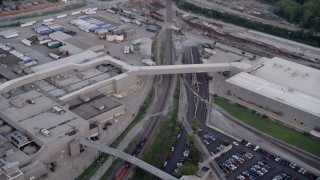 AX0001_172 - 5K stock footage aerial video track a train between Ford Motor Company and parking lots, Hegewisch, Chicago, Illinois