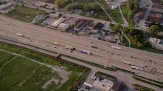 AX0001_175 - 5K stock footage aerial video panning across Kingery Expressway on a hazy day, in Lansing, Chicago, Illinois