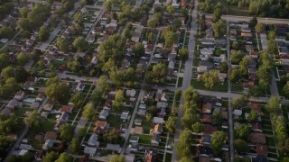 AX0001_176 - 5K stock footage aerial video reverse view of a Lansing residential neighborhood, revealing Memorial Junior High School, Lansing, Illinois