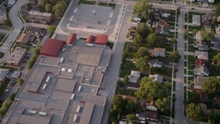 AX0001_177 - Aerial stock footage of 5K aerial  video reverse view of Memorial Junior High School, revealing homes in Lansing, Chicago, Illinois