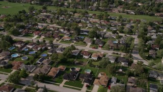 AX0002_001 - 5K stock footage aerial video flying by a suburban residential neighborhood, Calumet City, Illinois