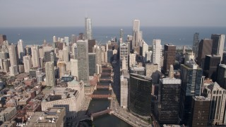 AX0002_038 - 5K stock footage aerial video tilt from bird's eye of W Fulton Street to reveal the Chicago River and skyscrapers, Downtown Chicago, Illinois