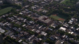 AX0002_059 - 5K stock footage aerial video bird's eye of neighborhood and school, tilt to reveal row houses in West Side Chicago, Illinois