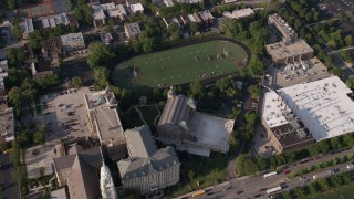 AX0002_062 - 5K stock footage aerial video of an orbit of St. Ignatius College Prep and football field, West Side Chicago, Illinois