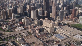 AX0002_063 - 5K stock footage aerial video tilt from freeway near Circle Interchange and reveal Willis Tower and Downtown Chicago, Illinois