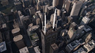 AX0002_068 - 5K stock footage aerial video tilt to bird's eye view of spires atop Willis Tower, Downtown Chicago, Illinois