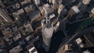 AX0002_071 - 5K stock footage aerial video tilt to bird's eye view of Trump International Hotel and Tower and the Chicago River in Downtown Chicago, Illinois
