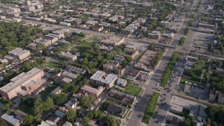 AX0002_099 - 5K stock footage aerial video follow S Stony Island Avenue past urban neighborhoods, South Chicago, Illinois