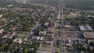 AX0002_100 - 5K stock footage aerial video fly over Mosque Maryam and follow S Stony Island Avenue past urban neighborhoods, South Chicago, Illinois