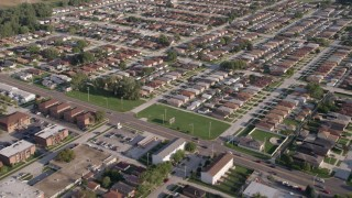 AX0002_104 - 5K stock footage aerial video of flying over residential neighborhoods in Lansing, Illinois