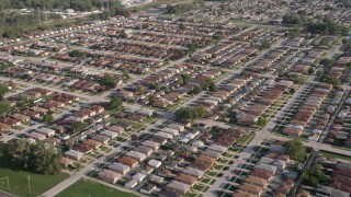 AX0002_105 - 5K stock footage aerial video of flying over rows of suburban homes in Lansing, Illinois
