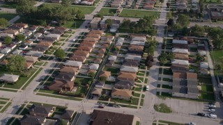 AX0002_106 - 5K stock footage aerial video of flying over a residential neighborhood, Lansing, Illinois
