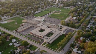 AX0003_001 - 5K stock footage aerial video tilt and flyby Thornton Fractional South High School in Lansing, at sunset, Lansing, Illinois