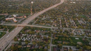 AX0003_003 - 5K stock footage aerial video of flying over residential neighborhoods and Kingery Expressway in Lansing, at sunset, Illinois