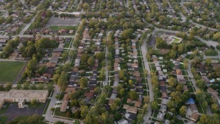 AX0003_004 - 5K stock footage aerial video of flying over residential neighborhoods at sunset, Calumet City, Illinois