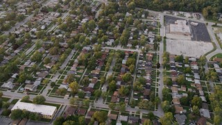 AX0003_005 - 5K stock footage aerial video of flying over neighborhood in Calumet City at sunset, Chicago, Illinois