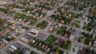 AX0003_007 - 5K stock footage aerial video of a reverse view of a residential neighborhood in Calumet City, Illinois at sunset