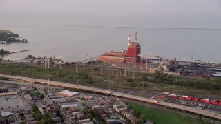 AX0003_009 - Aerial stock footage of Approaching State Line Generating Plant, Lake Michigan, Hammond, Indiana