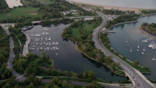 AX0003_017 - 5K stock footage aerial video of flying over Jackson Park Harbor at twilight, Chicago, Illinois