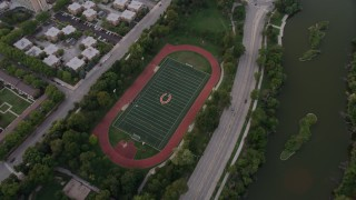 AX0003_018 - 5K stock footage aerial video of a bird's eye view of a hockey field in Jackson Park at twilight, Chicago, Illinois