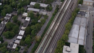 AX0003_019 - 5K stock footage aerial video of a bird's eye view of train tracks in Kenwood, at twilight, Chicago, Illinois