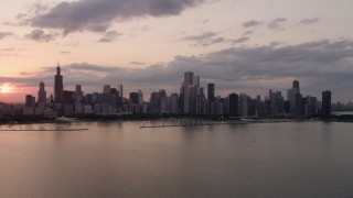 AX0003_030 - 5K stock footage aerial video of the Downtown Chicago skyline at sunset seen from Lake Michigan, Illinois