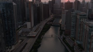 AX0003_036 - 5K stock footage aerial video of following Chicago River through Downtown Chicago, Illinois, sunset