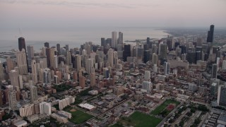 AX0003_056 - 5K stock footage aerial video of a wide view of the Chicago cityscape by Lake Michigan, Downtown Chicago, Illinois, sunset