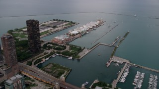 AX0003_061 - 5K stock footage aerial video of approaching Navy Pier and Lake Michigan from the Chicago River in Downtown Illinois, sunset