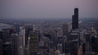AX0003_092 - 5K stock footage aerial video of panning from Willis Tower across Downtown Chicago, on a hazy twilight, Illinois
