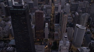 AX0003_097 - 5K stock footage aerial video of following N Michigan Avenue past Downtown Chicago buildings, at twilight, Illinois