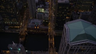 AX0003_108 - 5K stock footage aerial video bird's eye following N Clark Street over the Chicago River, through downtown, at twilight, Illinois