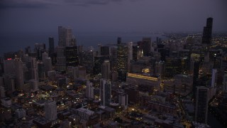 AX0003_113 - 5K stock footage aerial video of Downtown Chicago skyscrapers and high-rises at twilight, Illinois