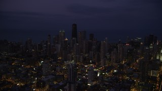 AX0003_137 - 5K stock footage aerial video of Downtown Chicago cityscape at nighttime, Illinois