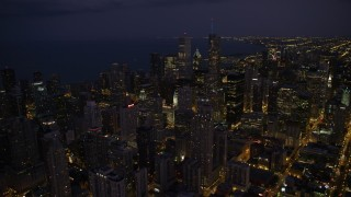 AX0003_142 - 5K stock footage aerial video of flying over Downtown Chicago at night, Illinois