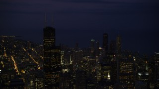 AX0003_152 - 5K stock footage aerial video of flying by Willis Tower and Downtown Chicago cityscape, Illinois, night