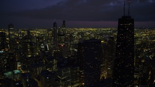 AX0003_160 - 5K stock footage aerial video of Downtown Chicago cityscape and John Hancock Center, at night with clouds, Illinois
