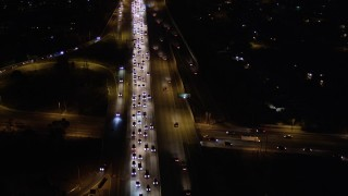 AX0004_001 - 5K stock footage aerial video fly over heavy nighttime traffic on Interstate 170 through Sun Valley, California