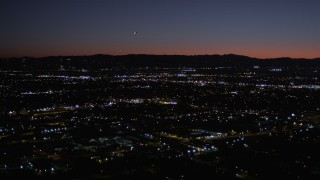 AX0004_003 - 5K stock footage aerial video of flying over Van Nuys suburban neighborhoods at night, California