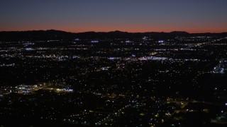 AX0004_004 - 5K stock footage aerial video of Van Nuys suburban neighborhoods at night, California