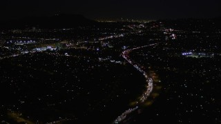 AX0004_006 - Aerial stock footage of Fly Over Interstate 170 at Night through Universal City, California