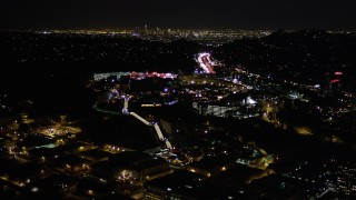 AX0004_007 - Aerial stock footage of Approaching Universal Studios Hollywood at Night