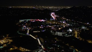 AX0004_008 - Aerial stock footage of Flying Over Universal Studios Hollywood at Night