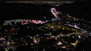 AX0004_008 - 5K stock footage aerial video of flying over Universal Studios Hollywood at night, California