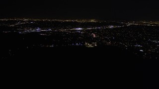 AX0004_014 - Aerial stock footage of Approach Griffith Observatory at Nighttime in California